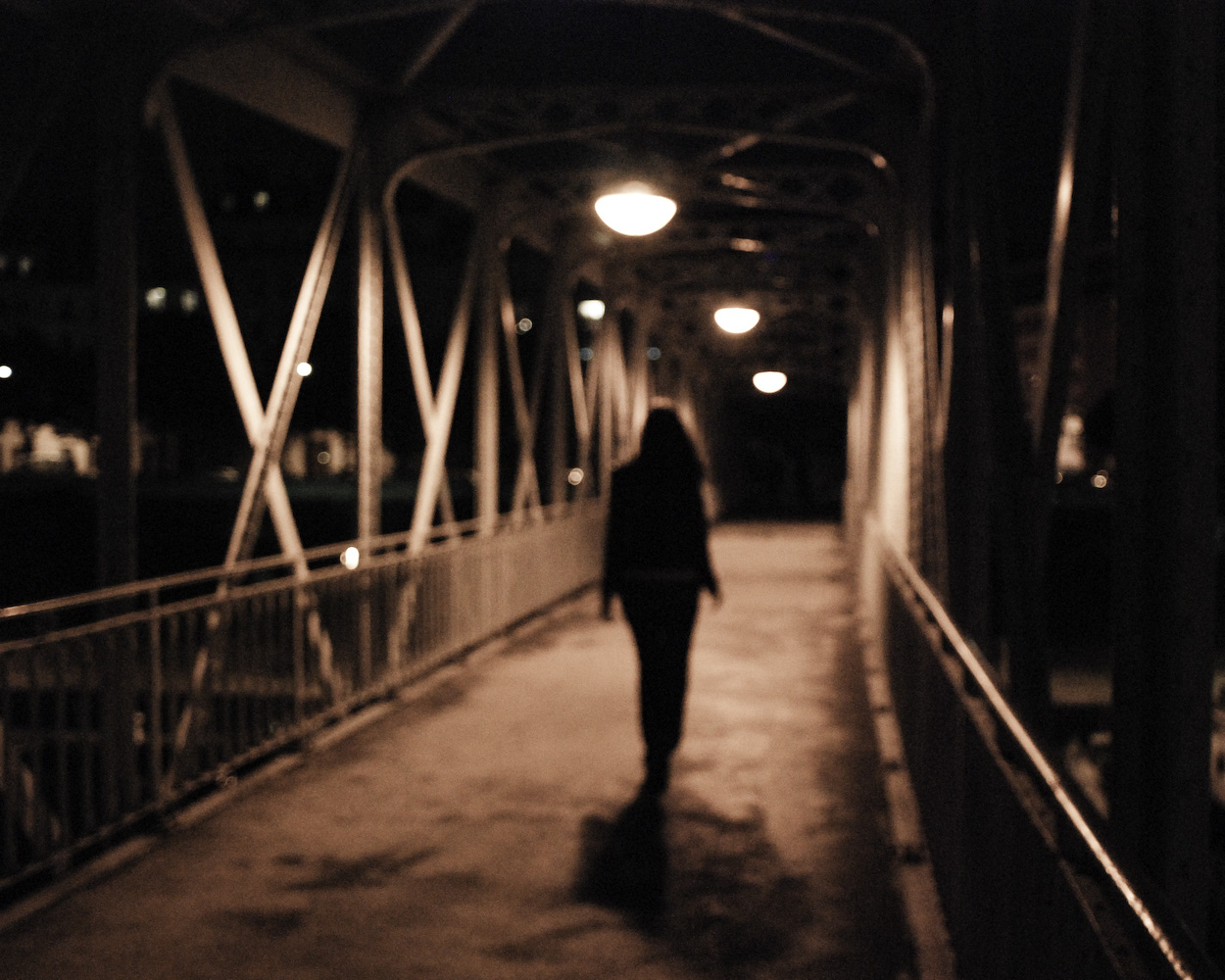 woman walk alone bridge